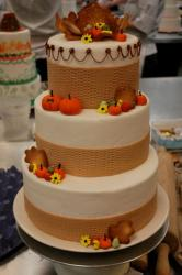 Three tier Halloween theme cake with pumpkins.JPG