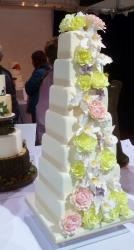 7 tier Square White Wedding Cake with Pink White & Green Flowers.JPG