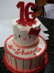 Two tier Hello Kitty sweet 16 birthday cake.JPG