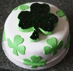White Clover cake in white with clover leaves cake decor.JPG
