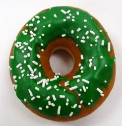 Irish donut with green frosting with  white sprinkles.JPG