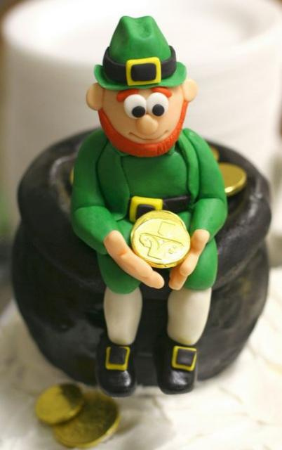 St. Patrick's Day Cake with Irish sitting on a pot of gold and holding a gold corne.JPG