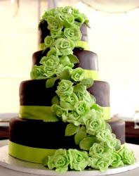 Four tier chocolate and lime green flowers wedding cake.JPG