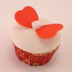 White cupcake with orange butterfly heart.JPG