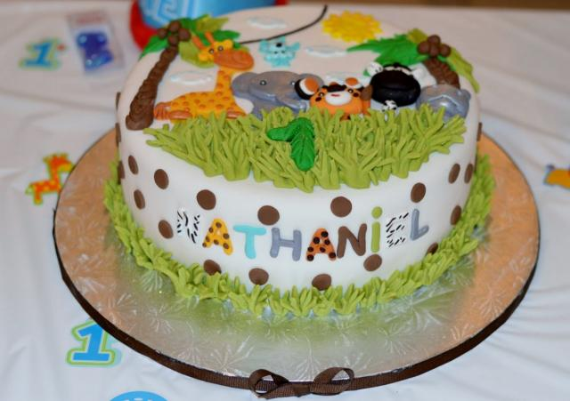 Animal Safari Theme 1st Birthday Cake With Name Of Child In Spots