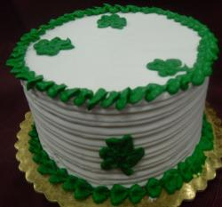 Large round St Patricks with dark green cake decor.JPG