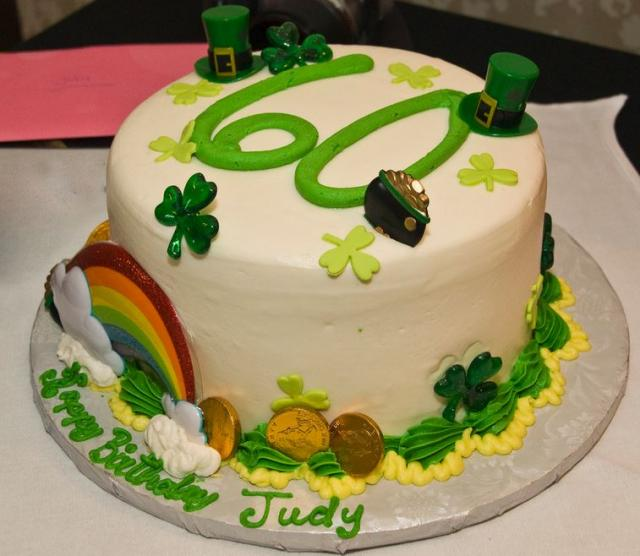 Modern St Patrick birthday cake with rainbow cake decor, gold, golen pot, St Patrick hats and cloves.JPG