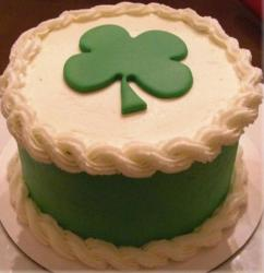 Round St Patricks cake with large clove.JPG