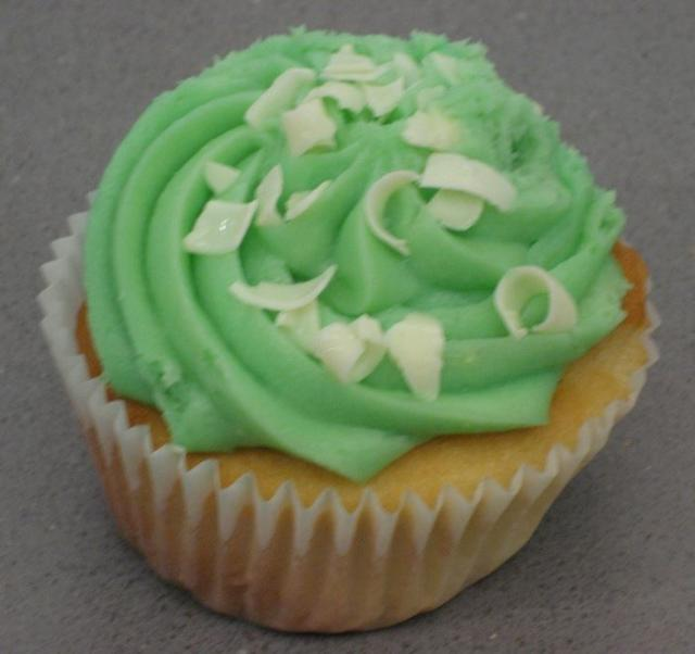 Vanilla cupcake with white chocolate with green frosting.JPG