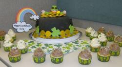 Birthday St Patricks cakes and cupcakes with Irish man cake topper and gold.JPG