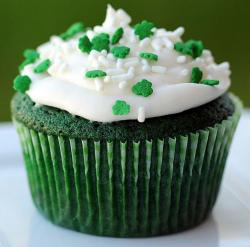 Chocolate green St. Patricks cupcake with cloves sprikles.JPG
