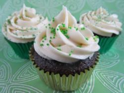 Cute St Patricks cupcakes with white frosting and green sprinkles.JPG