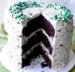 Delicious St Patricks cake with three cake layers with whipped cream, green and white sprinkles.JPG