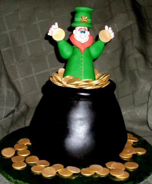 Golden pot cake with a man standing inside the pot with full of gold.JPG