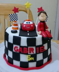 Lightning McQueen Checkered Birthday Cake with Replica of Kid on top.JPG