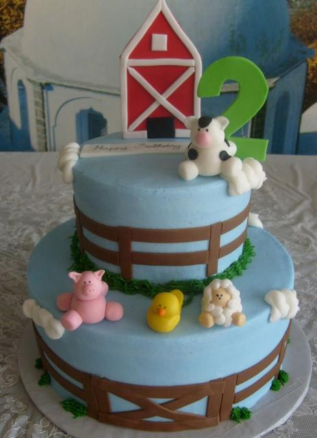 Farm animals birthday cake in two tiers.JPG