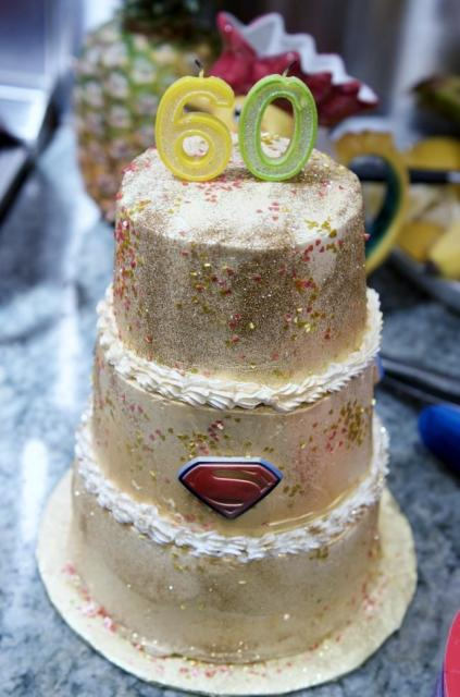 Gold Dusted 3 Tier 60th Birthday Cake With Superman Sign