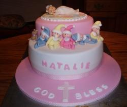Pink and white Christening Cake with baby figures topper