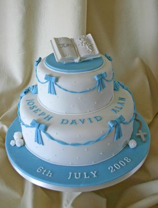 two christening cakes picture with bible as topper