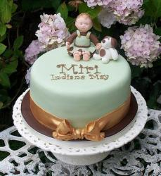 Light green Christening Cake with baby boy and a dog