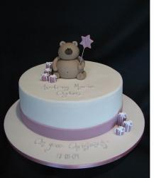 White Christening Cake with purple ribbon and teddy bear topper