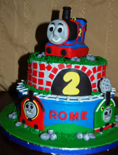 Thomas The Train Cake Topper On Two Tiers Cakes With