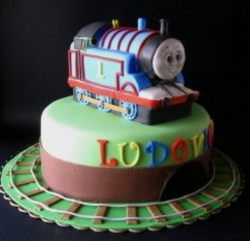 Modern Thomas the train with train rails and Thomas train cake topper pictures.PNG