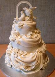 Doves and white drapes 3 tier wedding cake.JPG