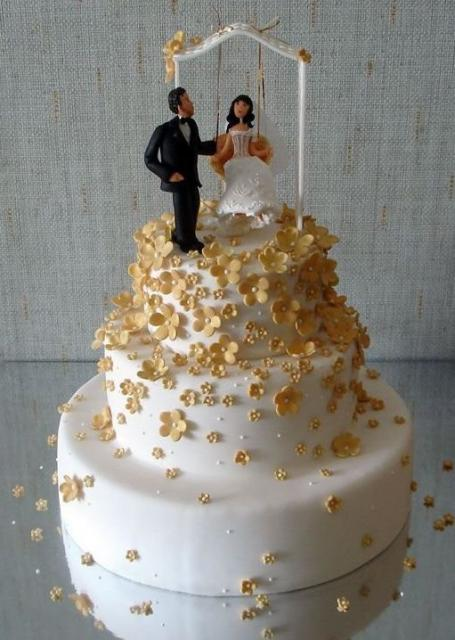 Three Tier Wedding Cake With Gold Flowers And Bride And Groom ToppersJPG