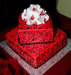 Two tier red box cake with fresh white flowers on top.JPG