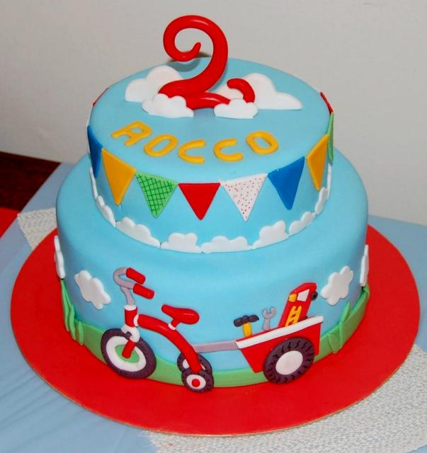 Two Tier Tricycle Theme Birthday Cake With Flags For Two