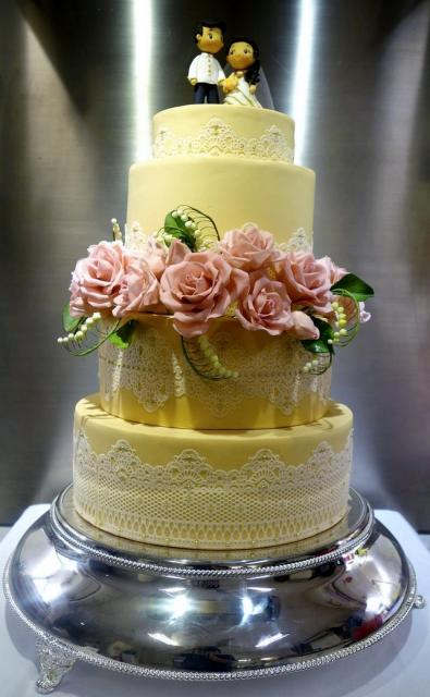 4 tier wedding cake with red roses 4 tier yellow wedding cake with pink roses and 10424