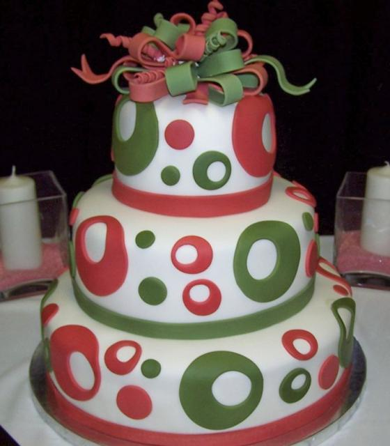 3 Tier round wedding cake with green and red circles and bowties.JPG