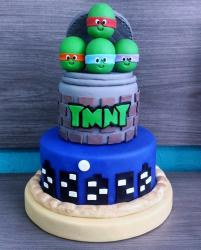 3 Tier TMNT Cake with Turtle Heads on Top.JPG