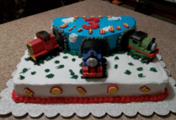 Kids birthday cake with Thomas and friends theme with tunnels.PNG