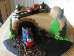 Thomas the train and car with tunnel and road_very cool kids birthday cakes photos.PNG