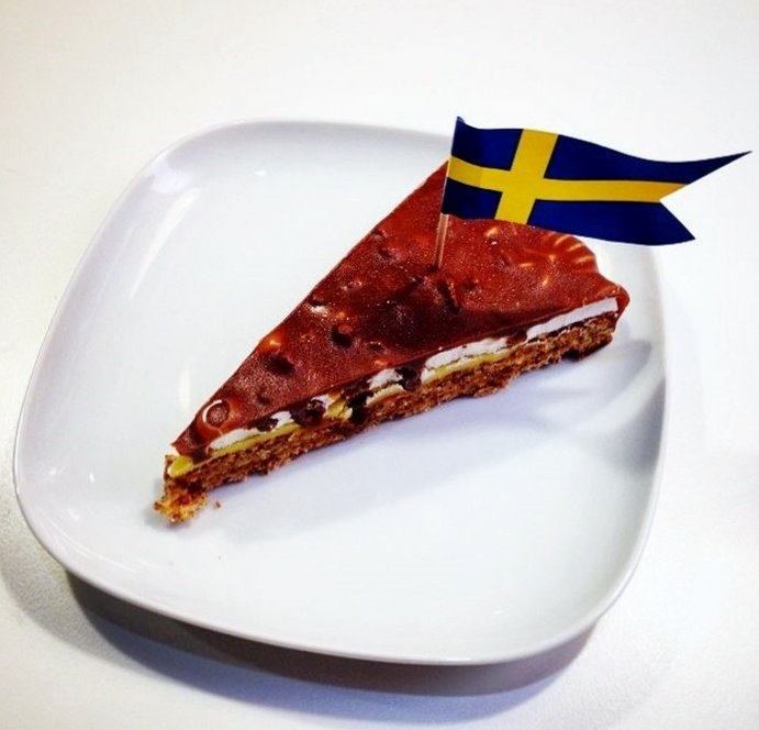 Slice of Swedish Chocolate Cake with Flag of Sweden.JPG