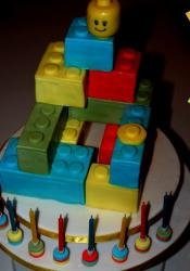 Lego blocks birthday cake with lego head cake topper and small candles.JPG