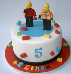 Chic looking kids birthday cake with lego theme and lego figure cake toppers and small lego cake decor.JPG