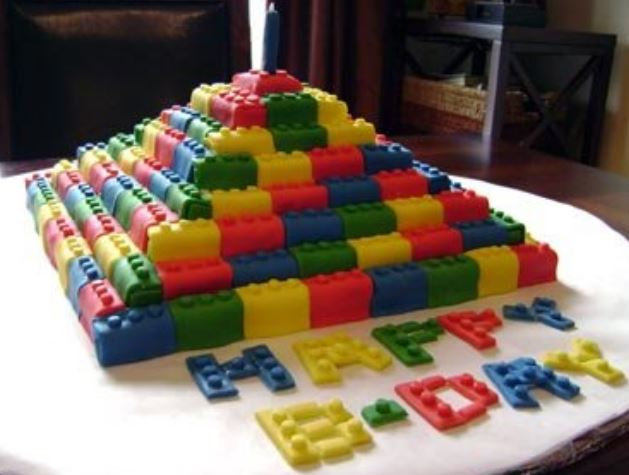 Large lego birthday cake in blue, yellow and green.JPG
