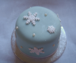Mini snowflake fruit cake in baby blue looking so pretty.PNG