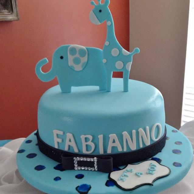 Blue round animal theme baby shower cake with giraffe and elephant on top.JPG