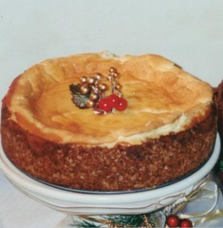 Picture of White Chocolate cheesecake with Christmas cake decor.PNG