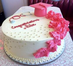 Graduation Cake with Pink Cap & Flowers & Stethoscope for Girl in Medical Field.JPG
