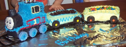 Thomas the train cakes with his waggons.PNG