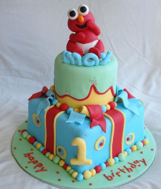 Cute baby Elmo two tier baby blue first birthday cake.JPG