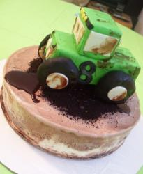 Kids birthday ice cream cake with green tractor ice cream cake topper and chocolate as dirt a very cool looking kids birthday ca