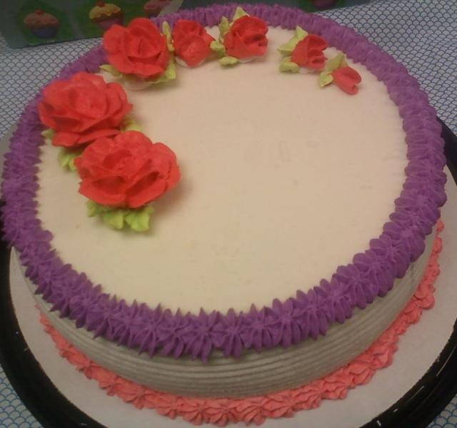Vannilla ice cream cake with floral cake decoration.JPG