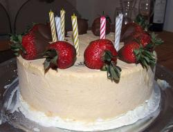 Vannilla ice cream cake with fresh strabberies with cake candles.JPG
