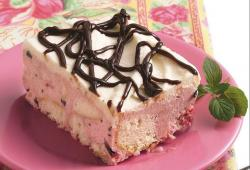 Vannilla strawberry ice cream cake with chocolate cake decor.JPG